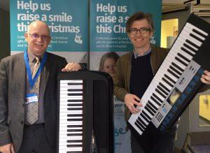 Gareth Malone signs keyboard for Raise