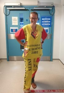 Sarah Jane Turner in Hornets scrubs